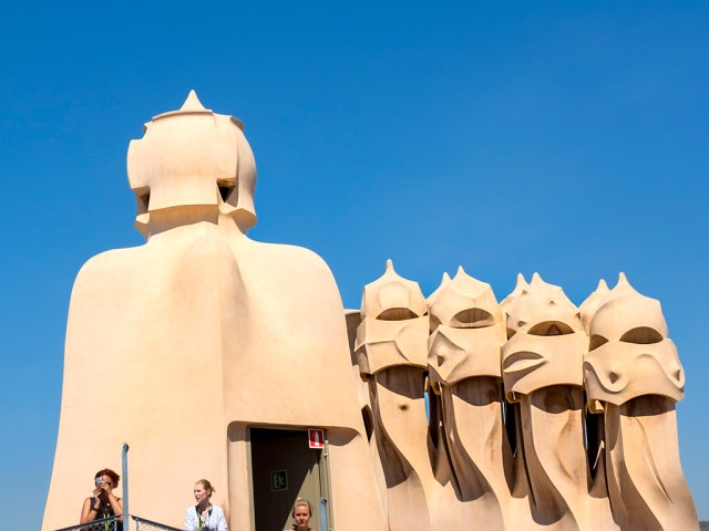 La Pedrera: The Garden of Warriors Gaudi chimney-pots faces Barcelona