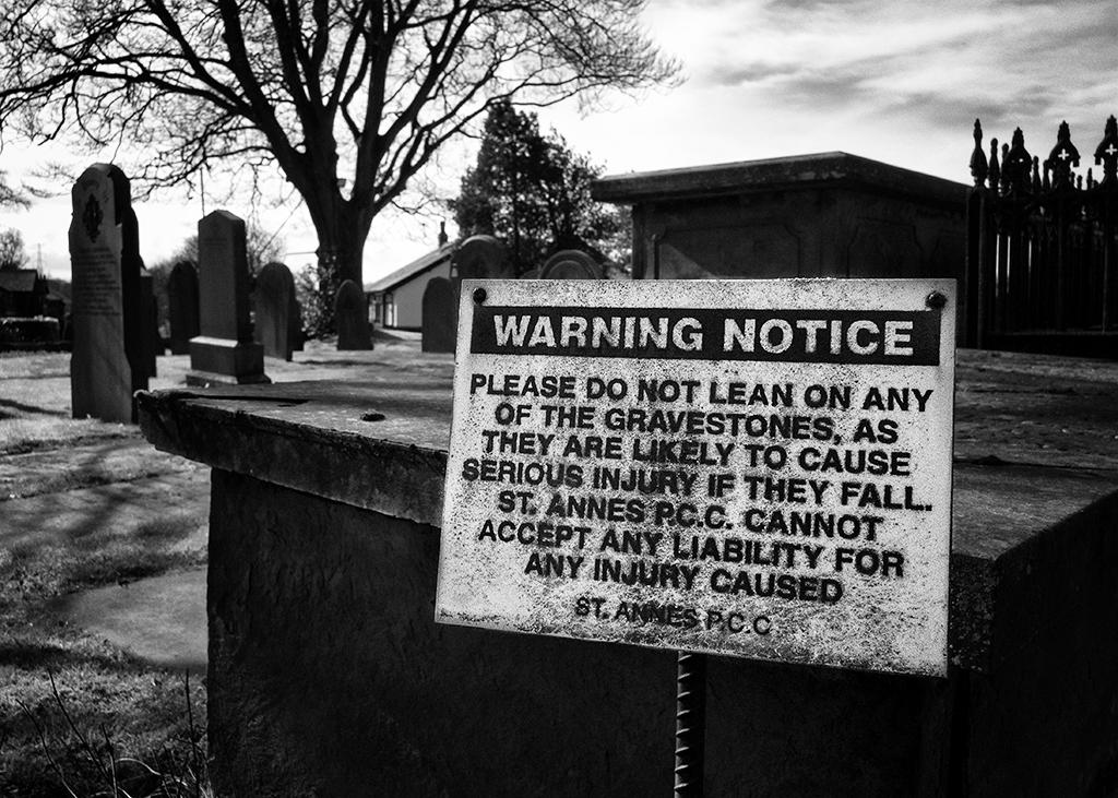 Warning Notice churchyard gravestones
