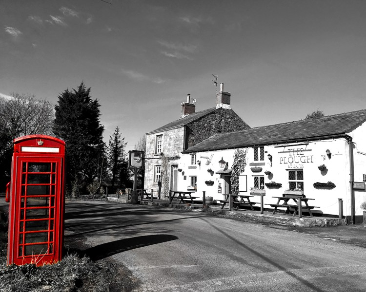 LOCAL PUB: The Plough at Eaves shadows telephone kiosk monochrome Black & White