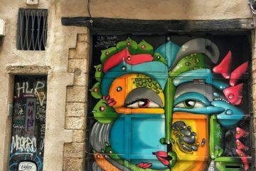 BARCELONA: Gothic Quarter doors eyes graffiti