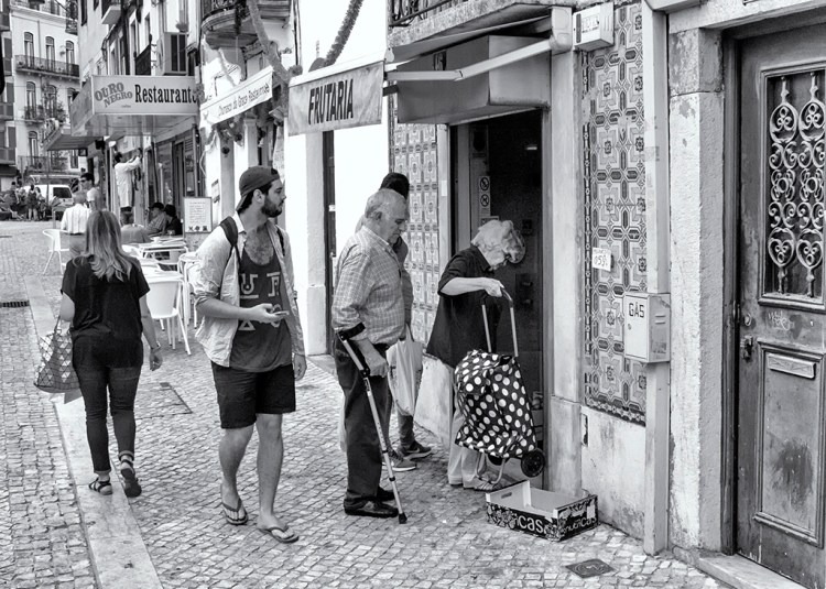candid city life street photography monochrome Lisbon life