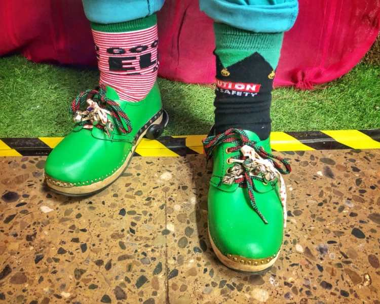 Christmas Elf wearing colourful clogs
