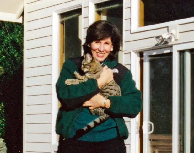 At the animal shelter, Pepper leapt into my arms and would not leave, as he did in this 1999 photo and repeated for the next 16 years.