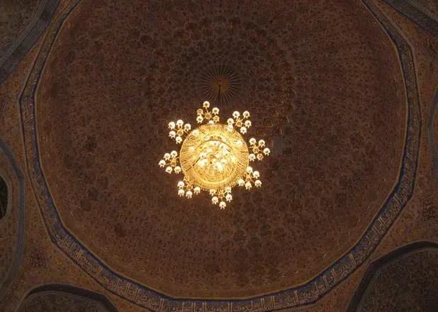 Intricate tiles and chandeliers inside an Uzbek mosque <br data-recalc-dims=