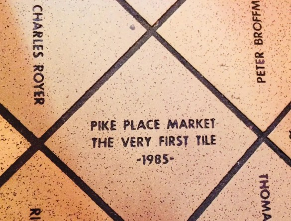 """Despite the holiday crowds, we found """"The Very First Tile"""" in Pike Place Market, one of 55,000 tiles. Each donor paid $35 in 1985 and 1986 to help save the Market from demolition Seattle, Feb 17, 2018"""