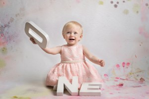 Helen Rowan Phototography Indoors first birthday studio happy sitter
