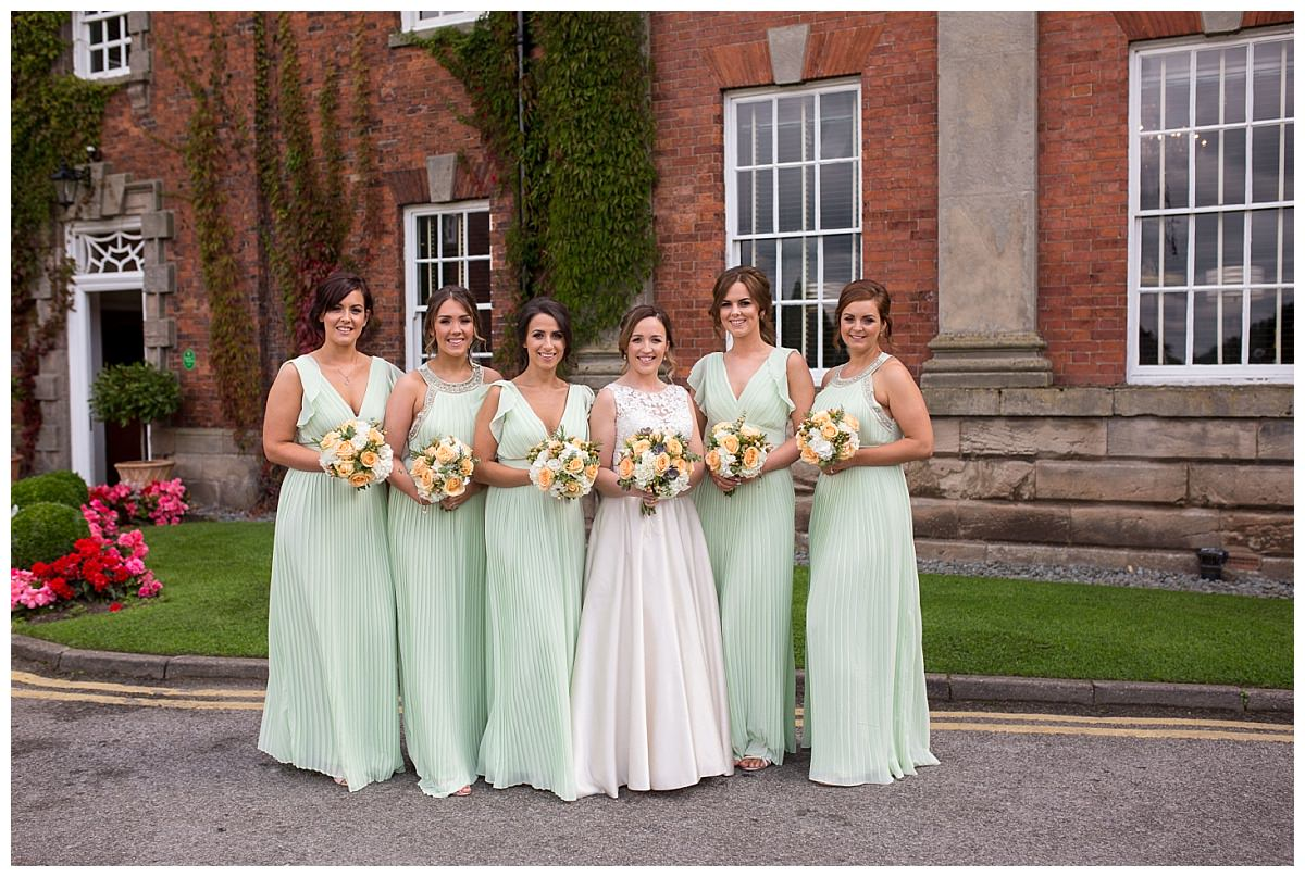 Bride and bridesmaids outside Mottram Hall