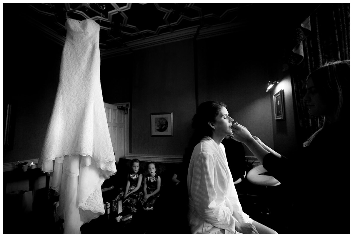 Bride having her make up applied at Crewe Hall
