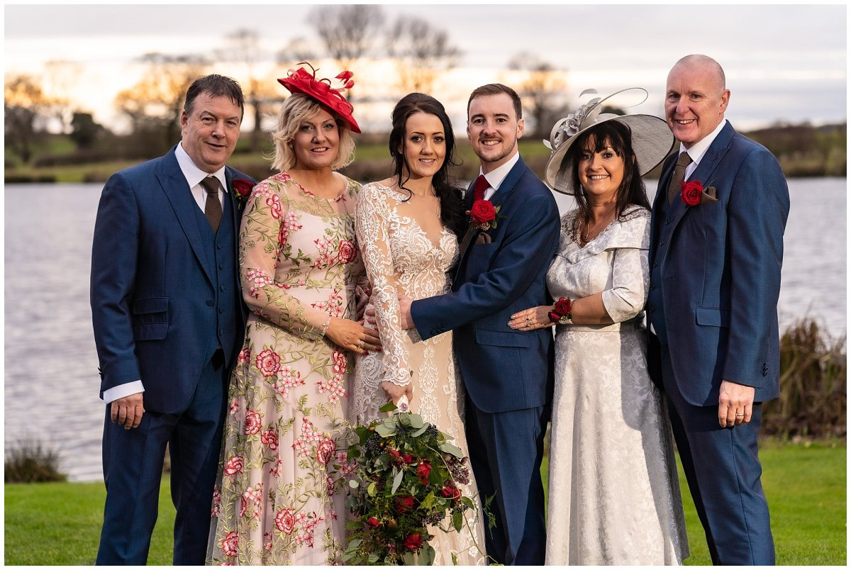 Bride and groom with parents at Sandhole Oak Barn