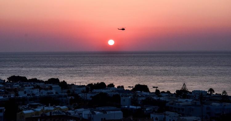 Sunrise Helicopter tour over Santorini