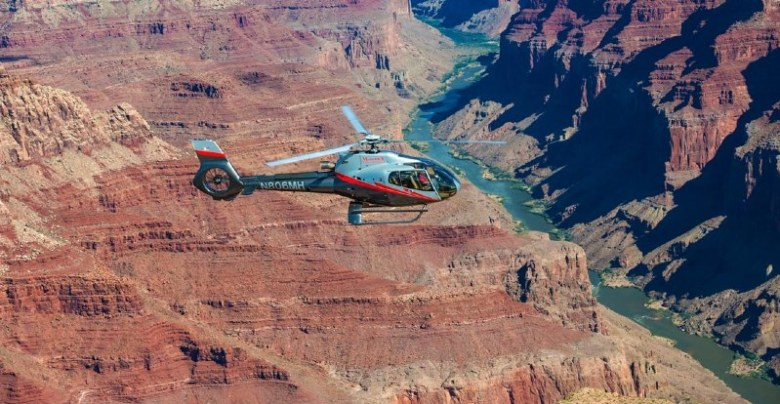Maverick helicopter flying-over Grand Canyon South Rim