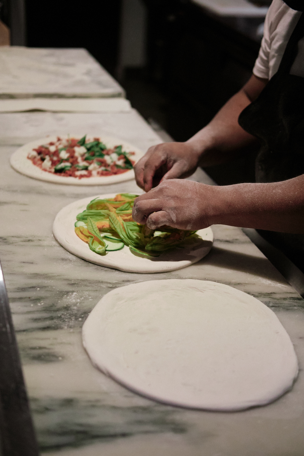 Chef Daniel Cutler of Ronan says customers like watching their pizzas being made by hand.