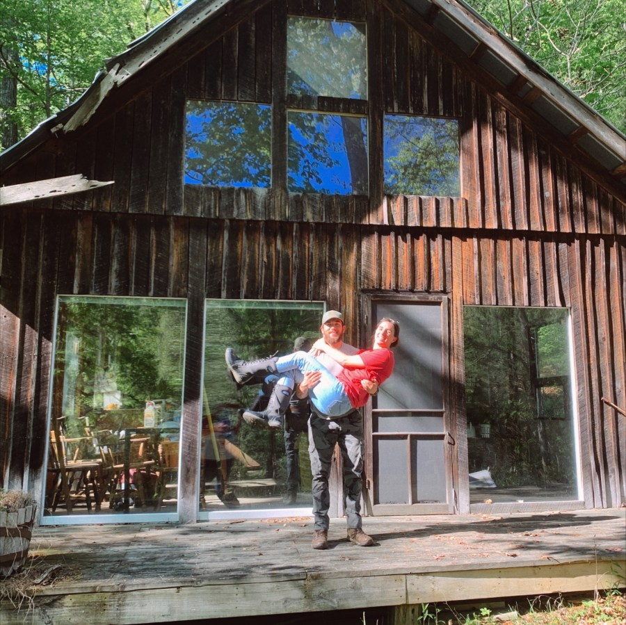 The Curtin's outside of their off the grid home in Kentucky.