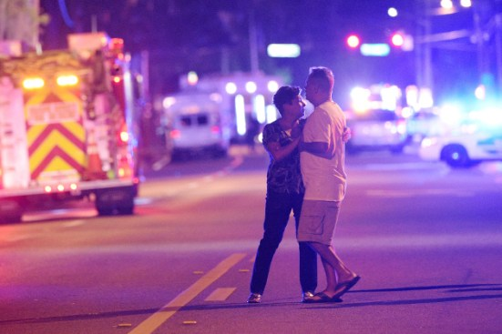 Family members wait for word from police after arriving down the street from a shooting involving multiple fatalities at a nightclub in Orlando, Fla., Sunday, June 12, 2016. (AP Photo/Phelan M. Ebenhack)