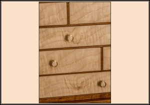 2015 edition of the Lily of the Valley cabinet in cherry with curly maple drawer fronts