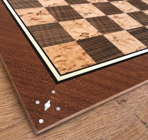 An inlaid chessboard with mother of pearl inlay by Heller & Heller Furniture