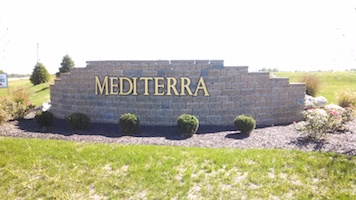 A picture of the entrance sign for Mediterra Communities