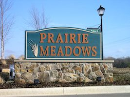 A picture of the entrance sign for Prairie Meadows Communities