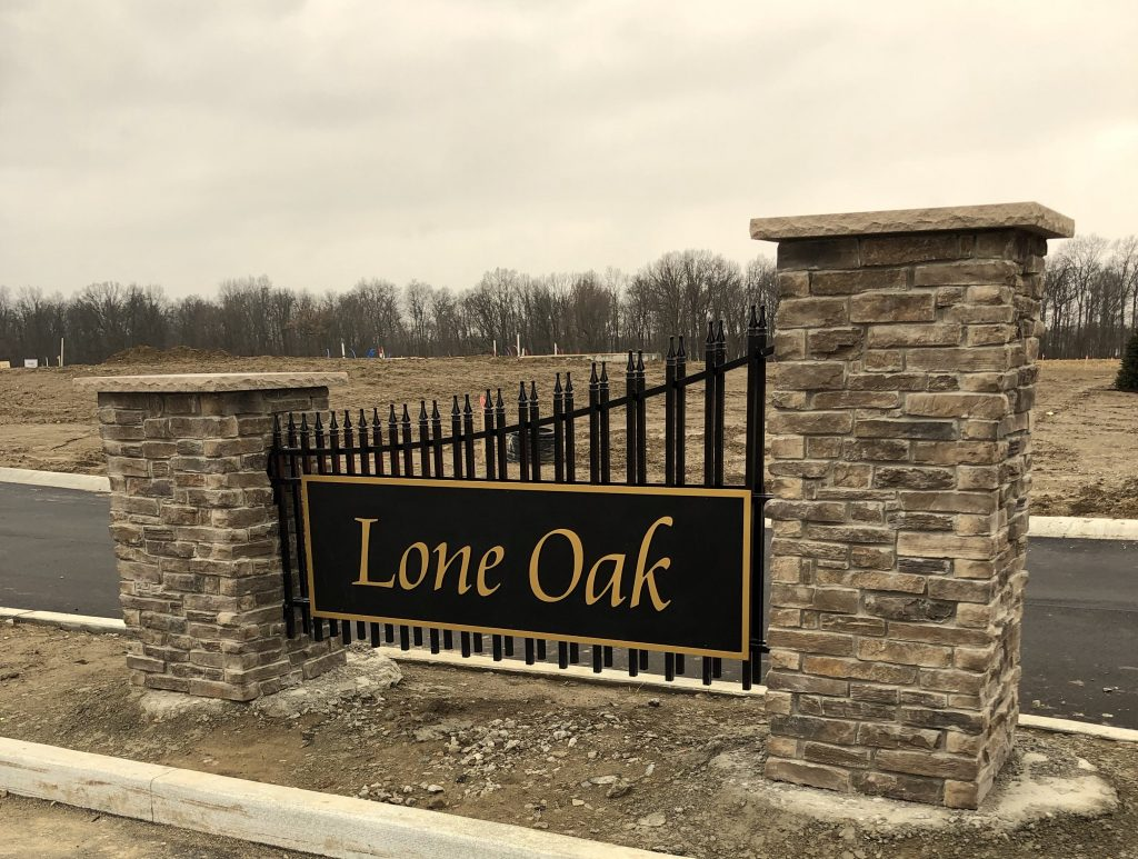 A picture of the entrance sign for Lone Oak Communities