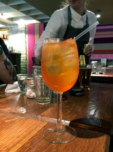 Cusco Spritz: Lemon-infused pisco, saffron-infused Aperol, sparkling wine, soda