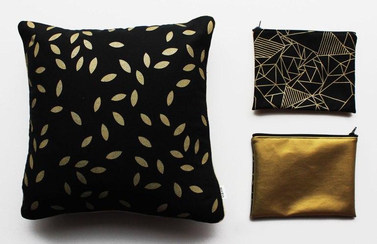 Coussin et Pochettes noir et or
