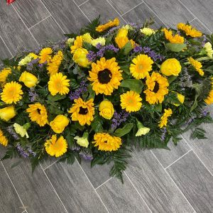Autumnal Casket Spray Funeral Flowers