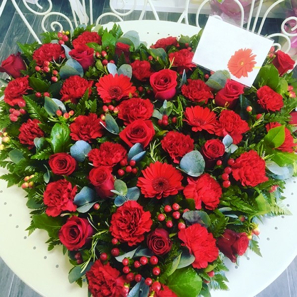 loose rose heart funeral flowers