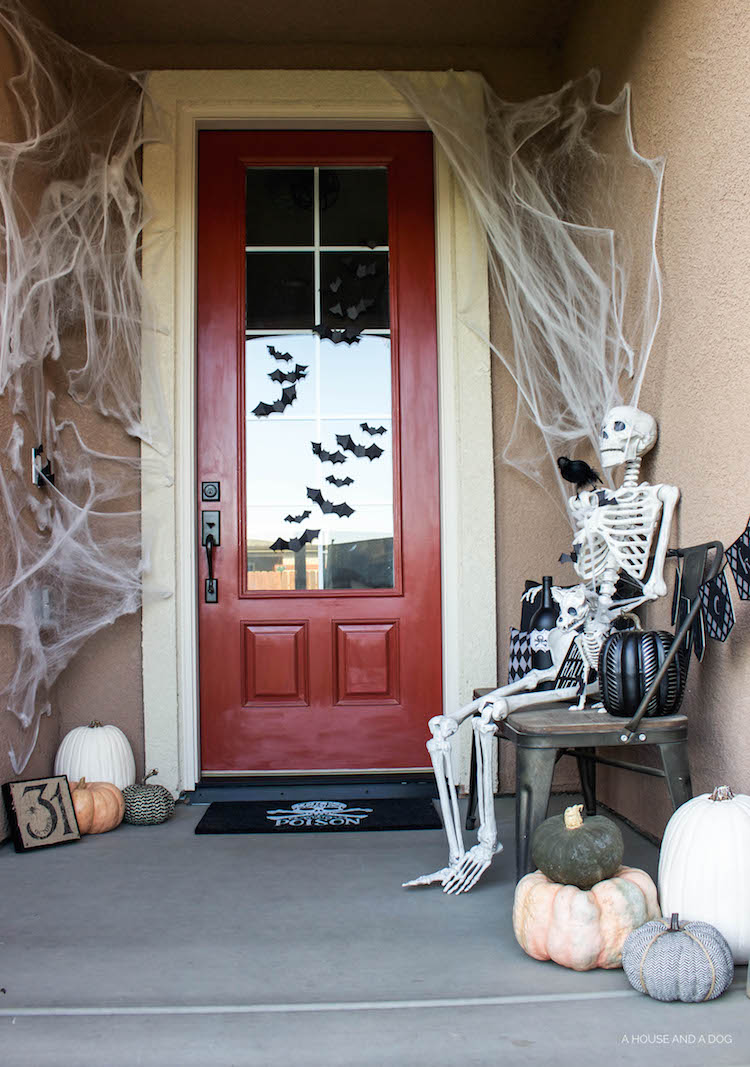 Simple & Spooky Halloween Porch - Skeletons & Bats | helloallisonblog.com