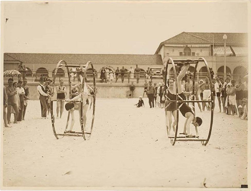1935, Chorus Girls wheel rolling at Bondi Beach