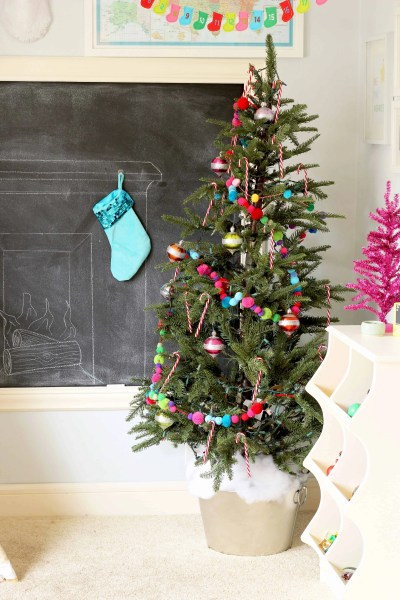 Colorful Christmas Playroom-bright colors like pink, aqua, yellow, red, and green make this a cute Christmas space for kids