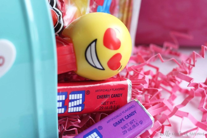 Monogram these sweet little tin mailboxes for the perfect Valentine's Day treat! Make these easy DIY mailboxes using stickers.