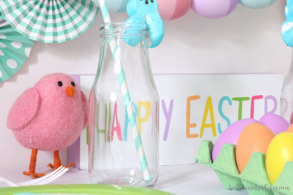 Kid's Easter table filled with bright colors and diy watercolor chargers!