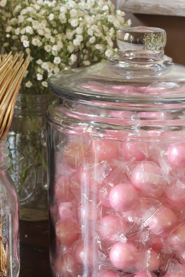 Take a look at some pink, white, and gold party decorations for a first communion party. It's a modern twist on a traditional event.