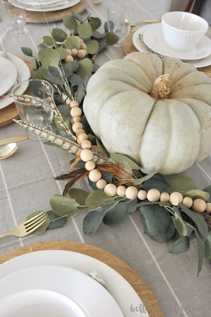 This DIY faux eucalyptus garland can be added to your mantel or table for Thanksgiving decor.