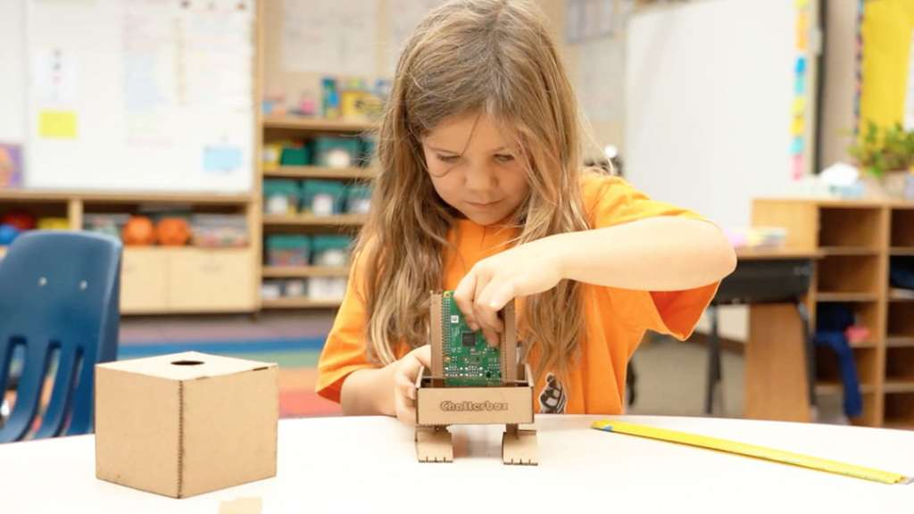 Girl building a Chatterbox smart speaker