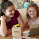 Girls teaching a Chatterbox Smart Speaker