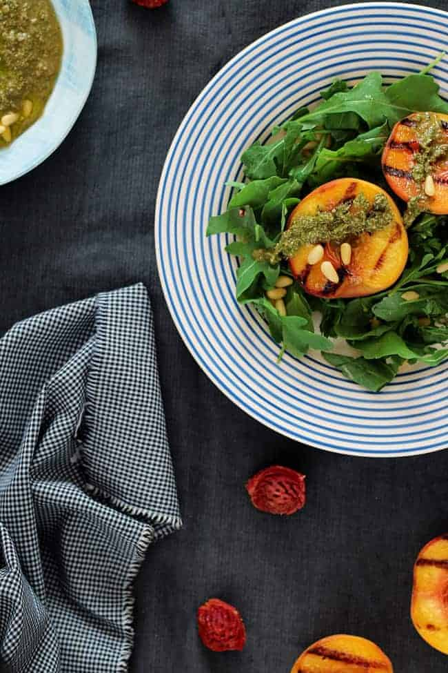 Arugula Salad with Grilled Peaches and Vegan Basil Pesto | HelloGlow.co