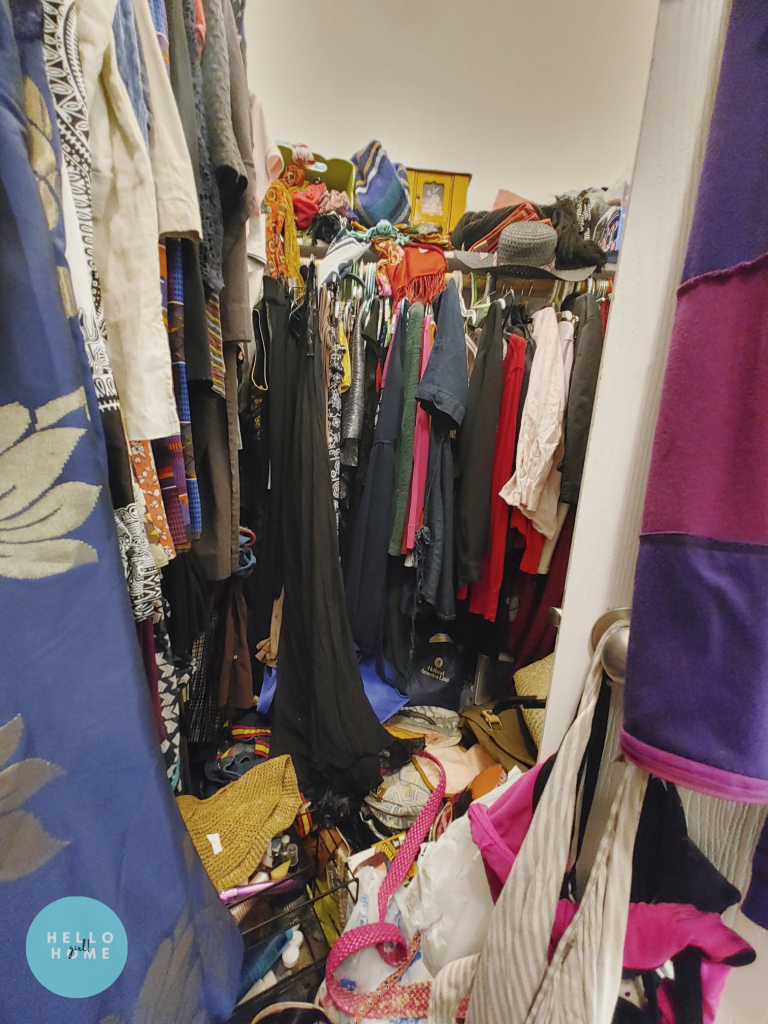 messy walk-in closet with clothes on the floor