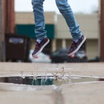 Photo by dan carlson at Unsplash - person jumping in the air over a puddle