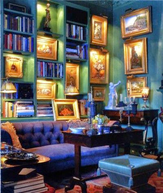 Green bookshelf in a blue room www.roomsrevamped.com