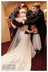 Sibling wedding day hug