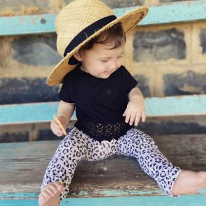 Summer with a hat, sitting on bench