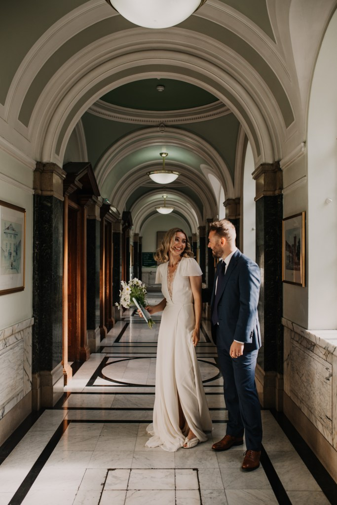 Happy couple at Islington Town Hall London by Hello Pictures Photography
