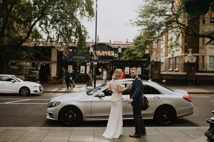 Bride and groom catching uber