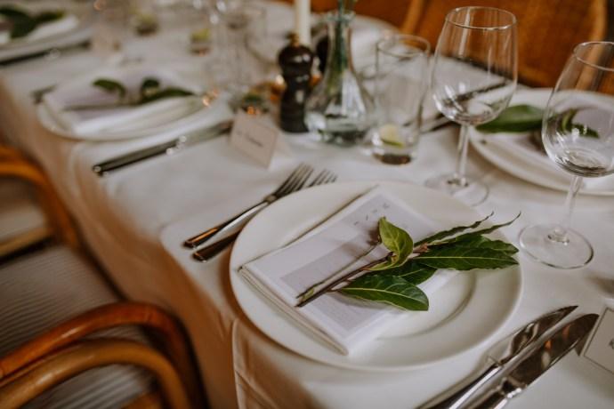Le Café du Marché restaurant wedding decor leaves