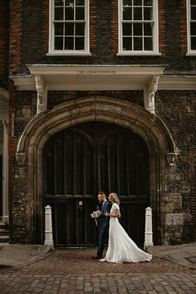 Wedding Photo of couple walking past The Charterhouse in London