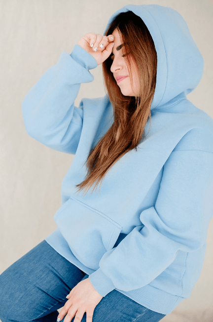 plus size woman wearing a light blue hoodie