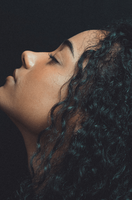 woman with black curly hair