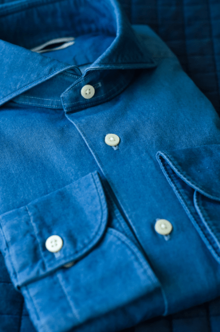 Close up of a blue button up shirt