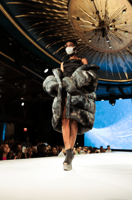 Woman walking down the runway in a large puffer jacket